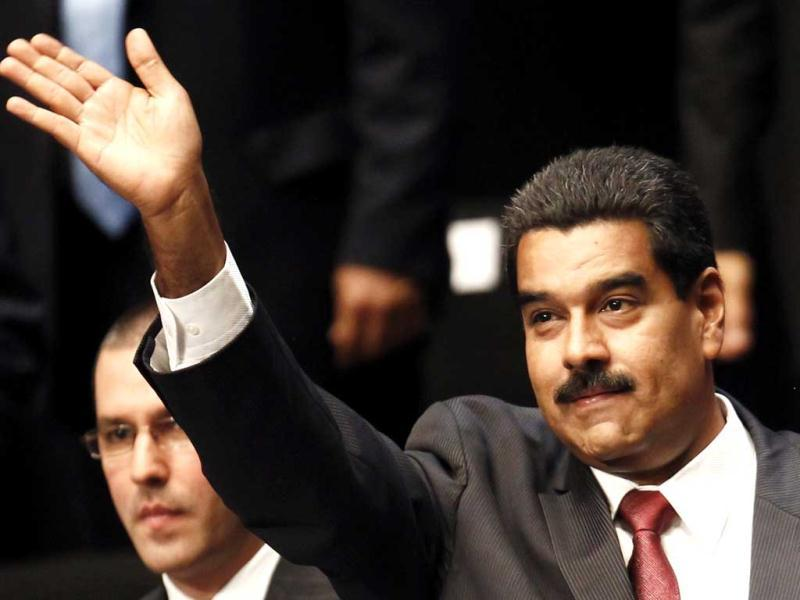 Venezuela's President Nicolas Maduro waves to supporters as he arrives at the oath-taking ceremony of new cabinet ministers in Caracas. (Reuters)