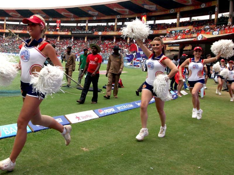 RCB cheer girls arrive on the ground during T20 match between Royal Challengers Bangalore (RCB) and Pune Warriors India (PWI) in Bangalore. (Sanjeev Verma/HT)