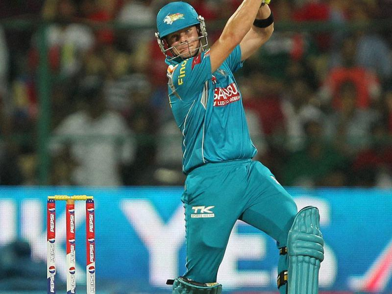 Pune Warriors' S Smith plays a shot during the T20 match against RCB at Chinnaswamy Stadium in Bangalore. (PTI)