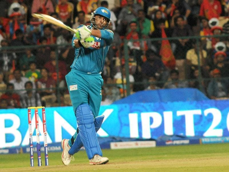 Pune Warriors India's Yuvraj Singh plays a shot during their T20 match against Royal Challengers Bangalore at Chinnaswamy Stadium in Bangalore. (UNI)