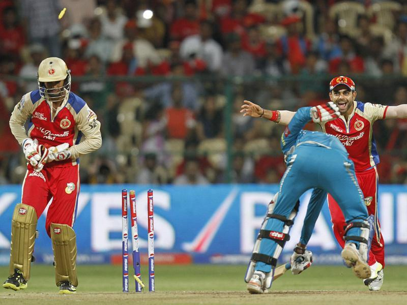 Pune Warriors India's Ishwar Chand Pandey bowled out by RCB's Chris Gayle during T20 match in Bangalore. (Sanjeev Verma/HT)
