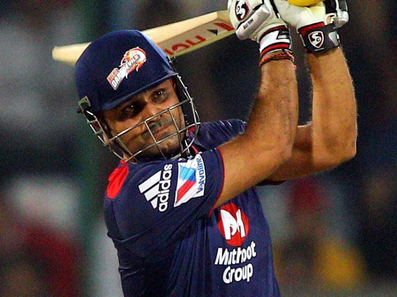 Delhi Daredevils Virender Sehwag plays a shot during the T20 match against Kings XI Punjab in New Delhi. (PTI)