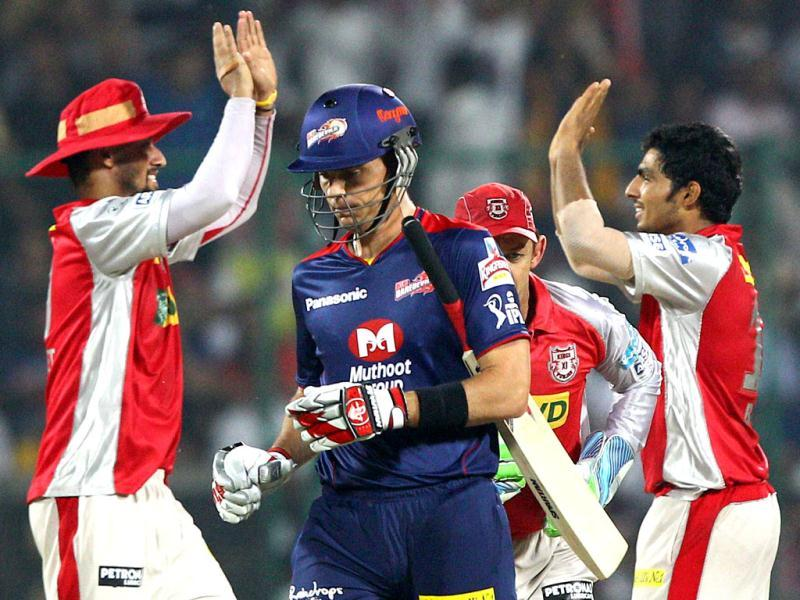 Kings XI Punjab bowler Harmeet Singh celebrates with teammates the wicket of Delhi Daredevils batsman Johan Botha during the T20 match in New Delhi. (PTI)