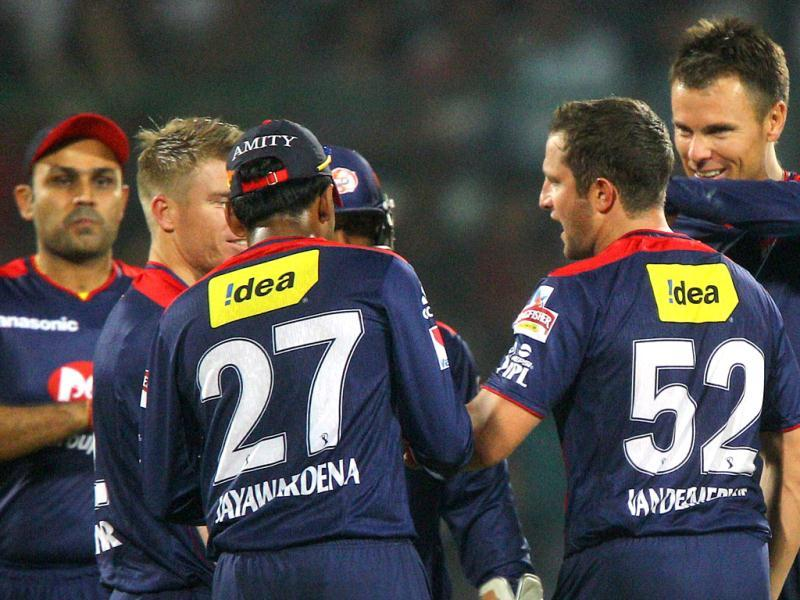Delhi Daredevils players celebrate the run out of Kings XI Punjab's Mandeep Singh during the T20 match in New Delhi. (PTI)