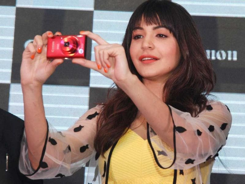 Anushka Sharma poses during the unveiling of a new range of Canon cameras in New Delhi on April 23, 2013. (AFP Photo)