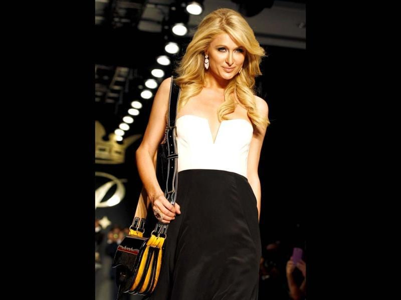 Paris Hilton models a handbag from her Spring/Summer collection during a fashion show in Bogota, Colombia. (AP Photo)