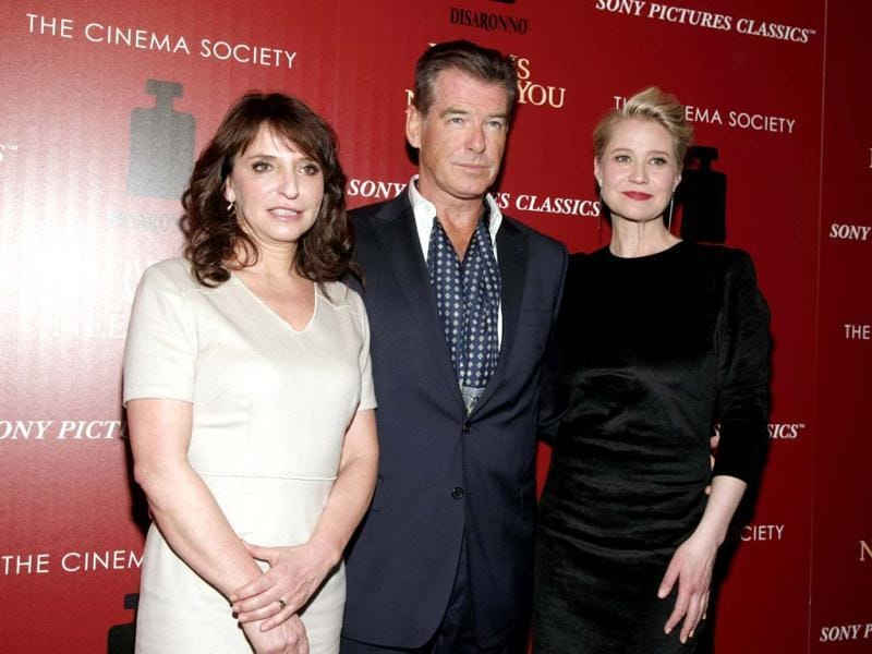 From left, director Susanne Bier, actor Pierce Brosnan and actress Trine Dyrholm attend a screening of Love Is All You Need presented by The Cinema Society & Disaronno 2013 in New York. (AP Photo)