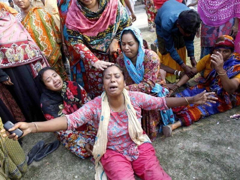 People mourn for their relatives, who are trapped inside the rubble of the collapsed Rana Plaza building, in Savar, 30 km (19 miles) outside Dhaka. (Reuters)