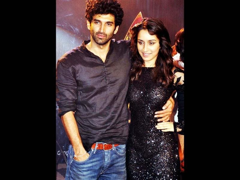 Aditya Roy Kapoor and Shraddha Kapoor were spotted in Mumbai promoting their first musical film Aashiqui 2. Here's a glimspe of the event. (AFP Photo)