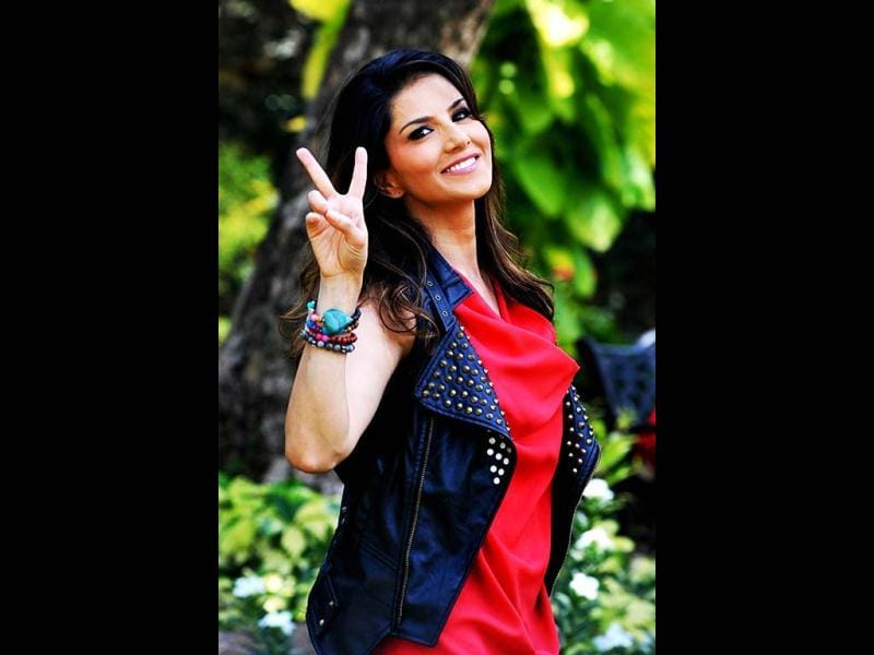 Sunny Leone shows a victory sign as she promotes an energy drink. AFP Photo