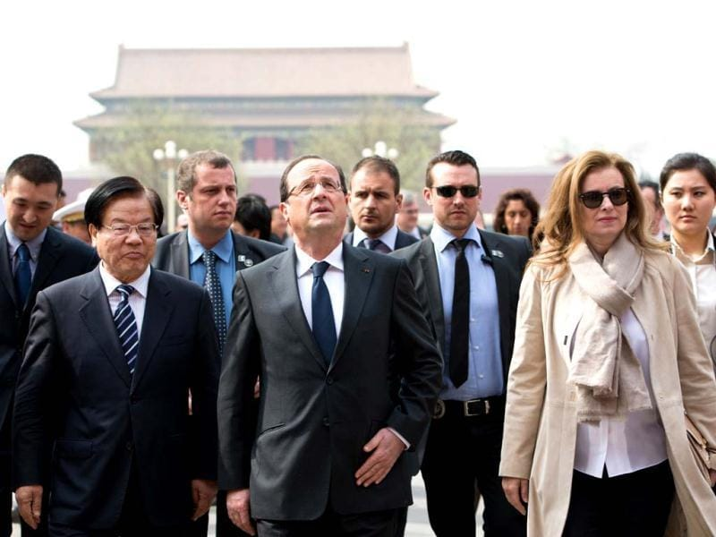 France's President Francois Hollande (3rd L) and his partner Valerie Trierweiler (2nd R-front) visit the Forbidden City as part of a two-day visit in Beijing. Hollande arrived in Beijing on April 25 for a two-day China trip aimed at boosting exports to China, with hopes that deals can be reached over the sale of aircraft and nuclear power. AFP photo