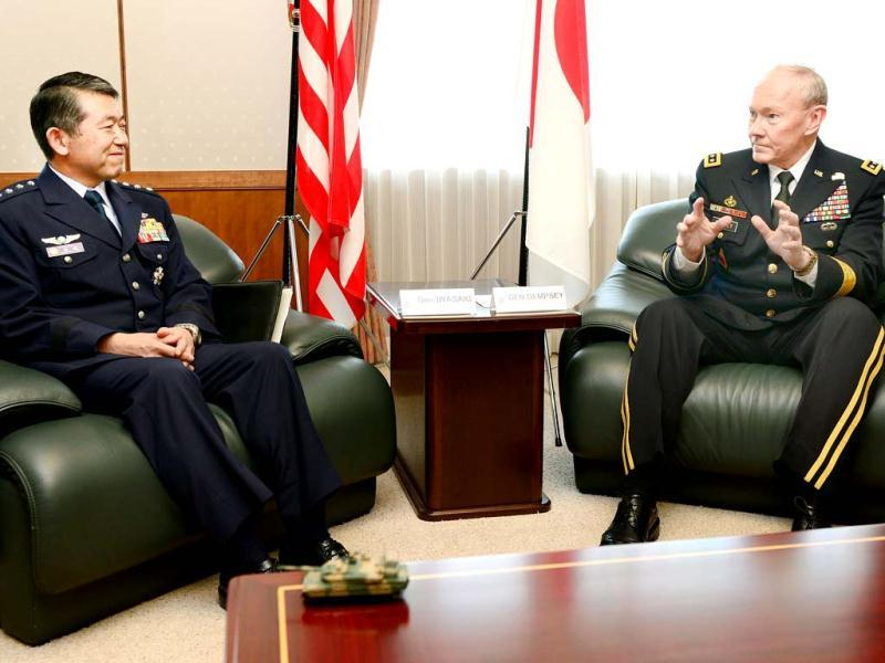 General Martin Dempsey (R), chairman of the US Joint Chiefs of Staff, chats with his Japanese counterpart Shigeru Iwasaki during their talks at the Defence Ministry in Tokyo. The US's top military officer said in Japan on April 25 that his troops were ready to act if North Korea turned its increasingly bellicose rhetoric into action. AFP PHOTO