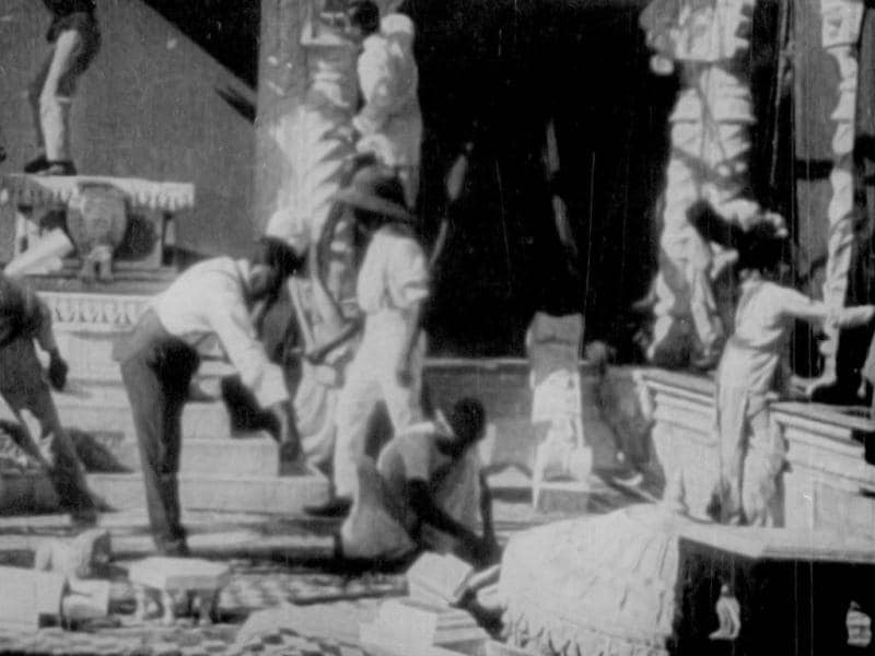 Producer-director-screenwriter Dadasaheb Phalke works on the sets of a palace scene for his film.