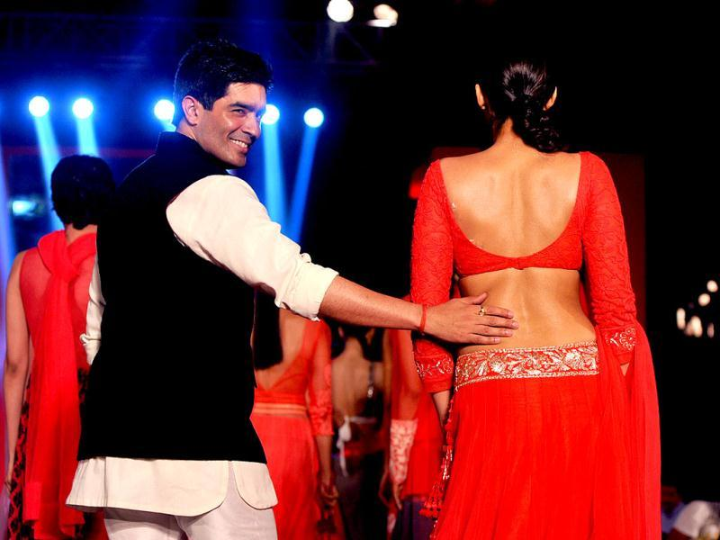 Sonam Kapoor shows her envious back as she walks the ramp with Manish Malhotra. AFP Photo