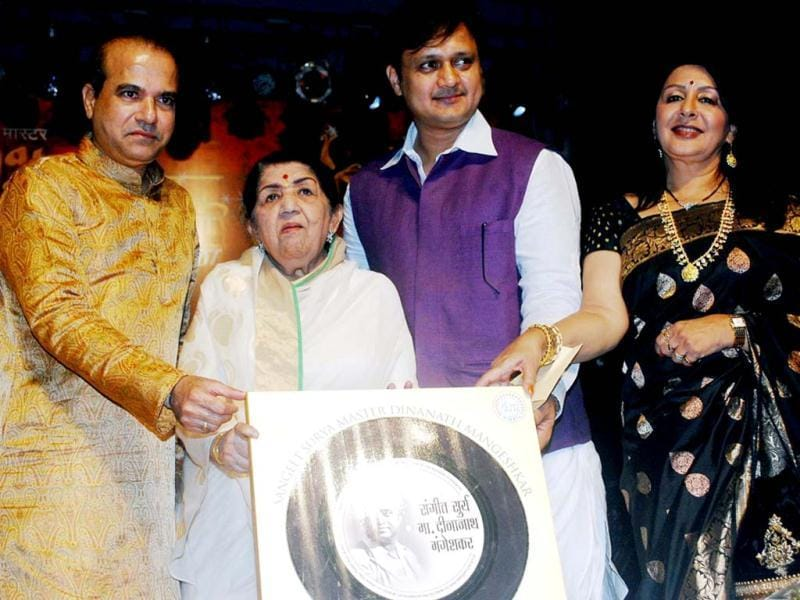 Lata Mangeshkar with singer Suresh Wadkar and Marathi actor Sunil Barve and Vandana Gupte launching the music album during the ceremony. (UNI Photo)
