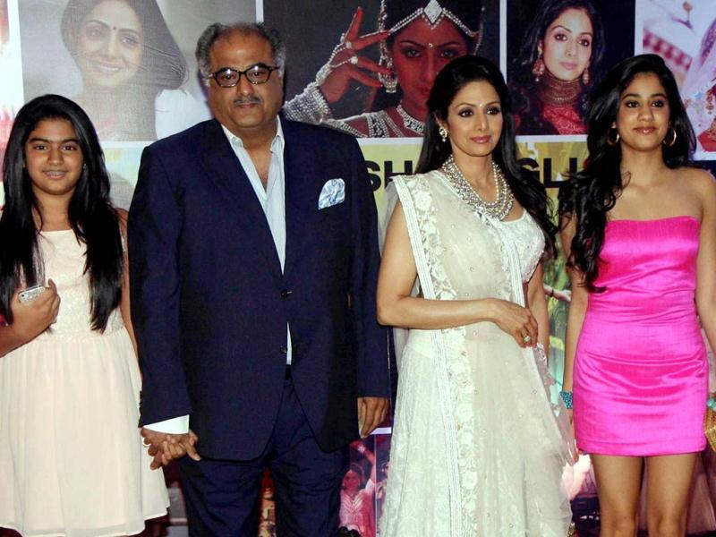 Sridevi (2nd R) with husband Boney Kapoor (2nd L) pose with their daughters Jhanvi and Kushi during a promotional event in Mumbai on April 23, 2013. (AFP Photo)