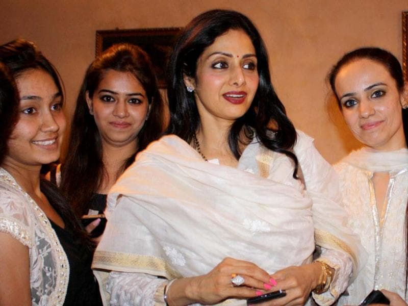 Sridevi Kapoor (C) talks with fans as she arrives in Amritsar late April 24, 2013. Sridevi visited the city to pay her respects at the Sikh Shrine The Golden Temple. (AFP Photo)