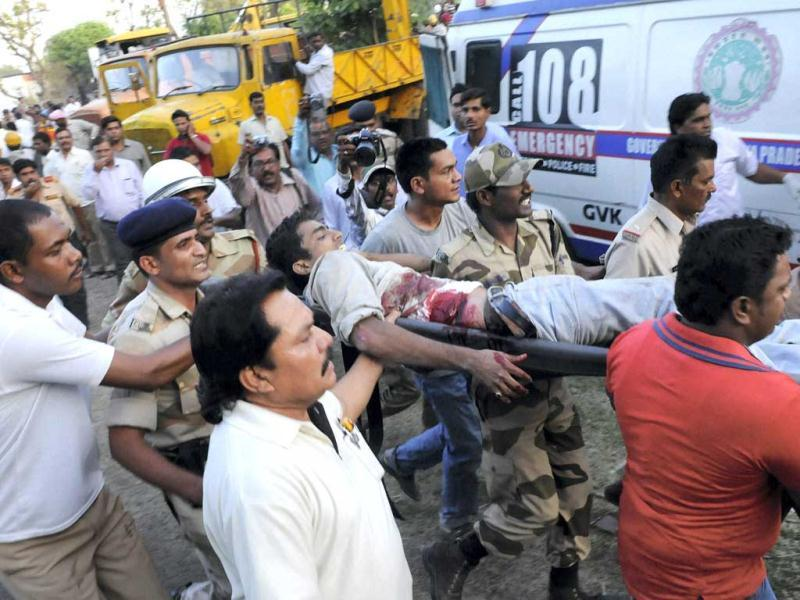 CISF jawans carrying an injured to an another hospital after a portion of the two-storied Kasturba Gandhi Hospital collapsed in Bhopal. (PTI)