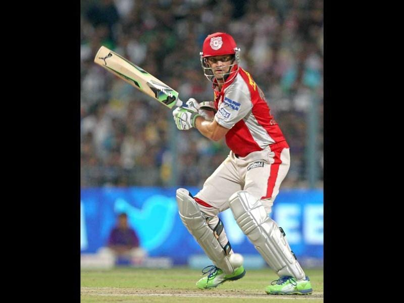 Kings XI Punjab's captain Adam Gilchrist plays a shot against KKR during the T20 match in Kolkata. (PTI)