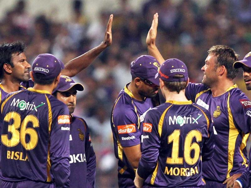 KKR bowler Jacques Kallis celebrate with his teammates after dismissal of Kings XI Punjab batsman Mandeep Singh during the T20 match in Kolkata. (PTI)