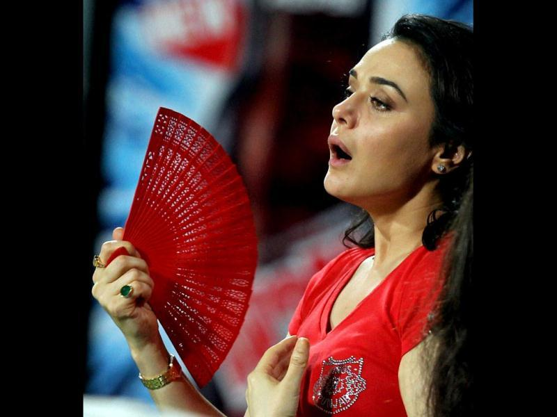It's hot in here: Preity Zinta gestures as she watches the match against KKR during the IPL 6 match in Kolkata. PTI Photo