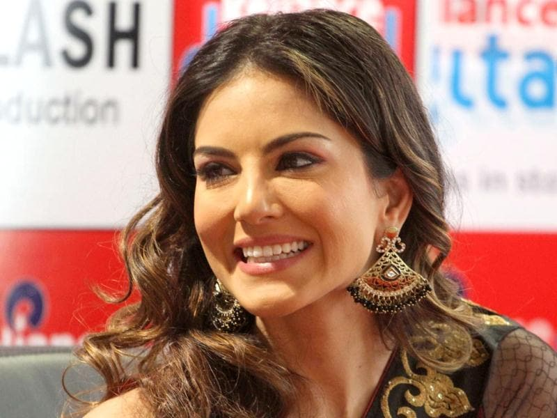 Sunny Leone smiles at a press conference supporting her upcoming movie 'Shootout At Wadala' in Ahmadabad on Friday. (AP Photo)