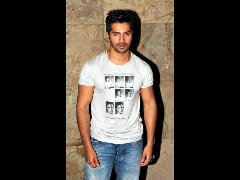 SOTY actor Varun Dhawan poses in a Marlon Brando t-shirt at the film premiere. (AFP Photo)