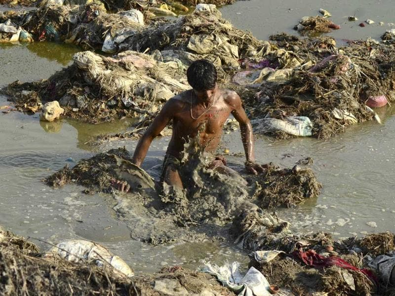 Filth at the banks of River Ganga at Sangam in after the devotees left the sacred river polluted during the Kumbh Mela festival in Allahabad. (Sheeraz Rizvi/HT)