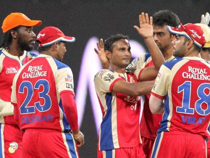 Royal Challengers Bangalore players celebrate the dismissal of Mumbai Indians batsman D Smith during the T20 League match in Mumbai. PTI photo