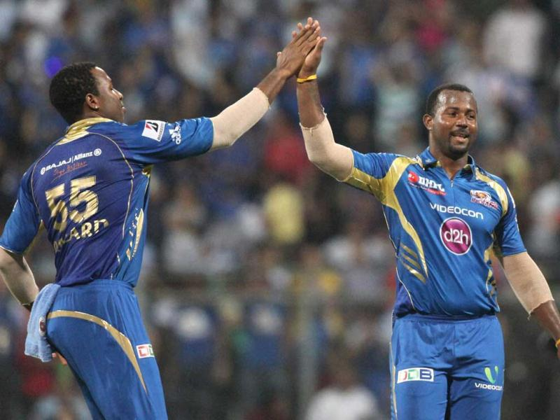 Mumbai Indians player D Smith celebrates the dismissal of Royal Challengers Bangalore player S Tiwari during the T20 League match in Mumbai. PTI photo