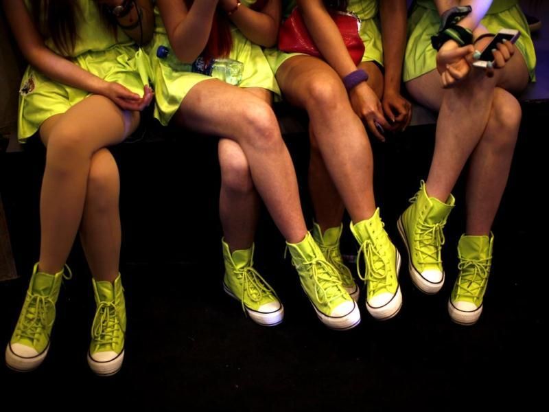 Girls sit as they watch the 2013 B-BOY Shanghai breakdancing competition in Shanghai. Now in its seventh year running, the competition is considered China's most important hip hop festival, where dance crews from all over the world, including Russia and Korea, compete in front of a panel of international guest judges. Reuters