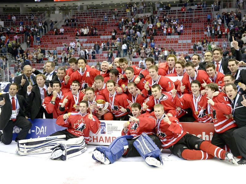 Canada's team poses for a photo after their winning match against the US team at the World Under 18 Hockey championships in Sochi.(AP)