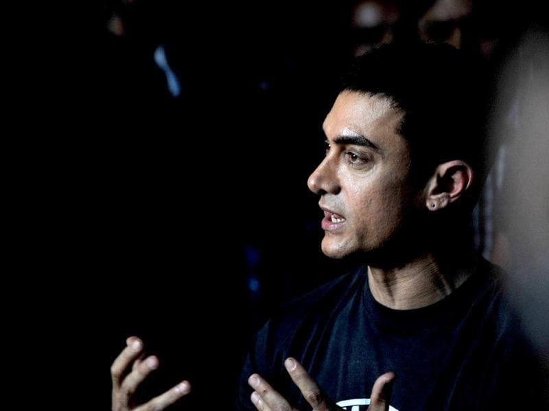 Aamir Khan chats with the media during the event. AFP Photo
