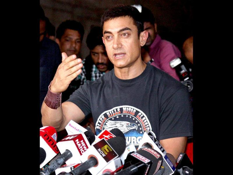 Actor Aamir Khan interacts with the media at an event celebrating his 25 glorious years in Bollywood. PTI Photo