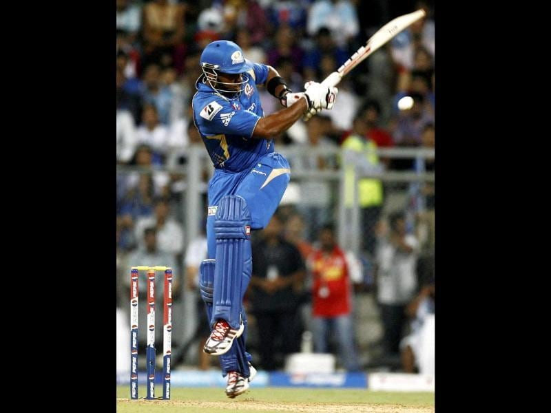 Mumbai Indians batsman K Pollard plays a shot during T20 match against Kings XI Punjab in Mumbai. PTI Photo by Shashank Parade