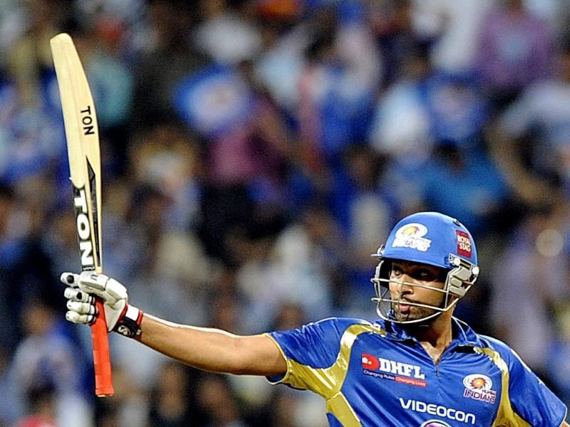 Rohit sharma of Mumbai Indians celebrates his 50 during their match with Kings XI Punjab in Mumbai. HT Photo/Anshuman Poyrekar