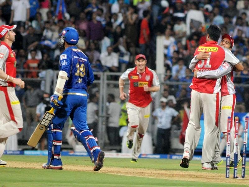 Kings XI Punjab players celebrating after taking the wicket of Mumbai Indian player Dinesh Karthik during T20 match at Wankhede stadium. UNI
