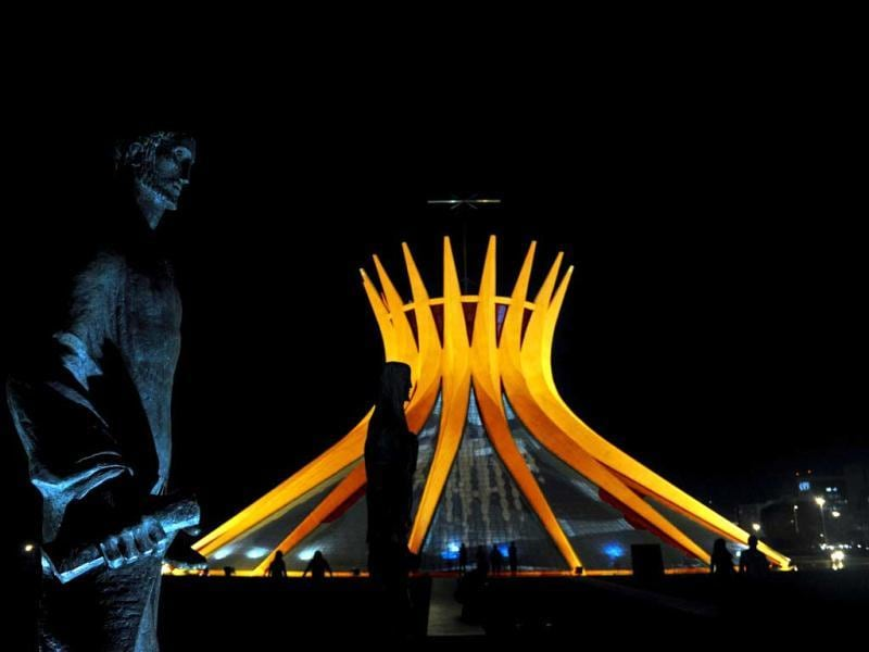 Brasilia's Metropolitan Cathedral is illuminated in orange in honor of Queen Beatrix of the Netherlands. (AFP)