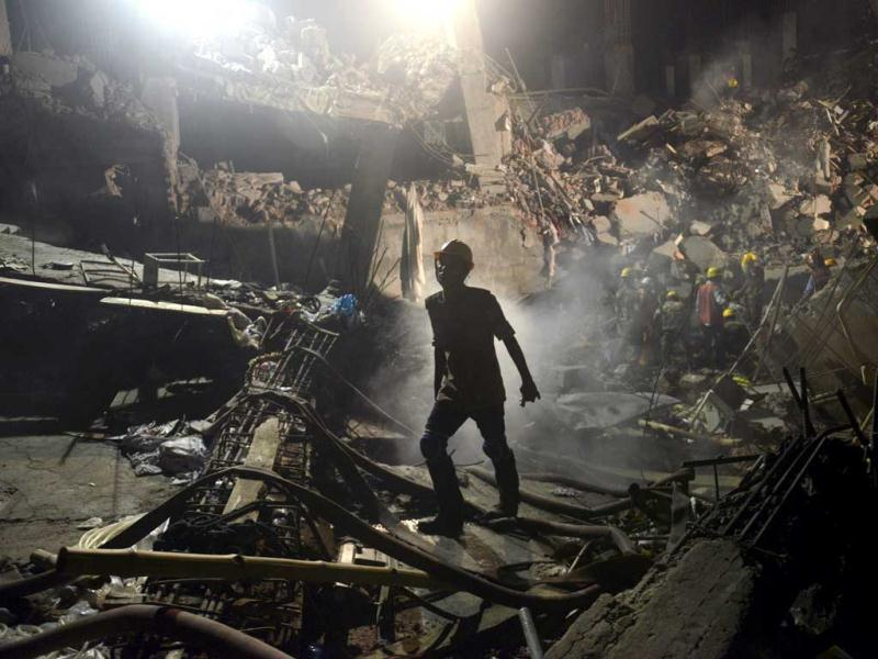 A worker leaves the site where a garment factory building collapsed near Dhaka, Bangladesh. (AP)