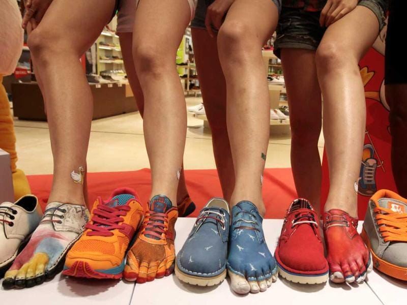 Feet painted like shoes are displayed during the opening ceremony of South Korean shoe store LesMore in Seoul. (AP)