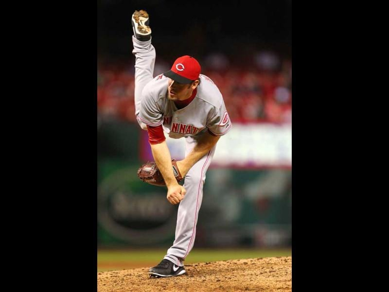 Reliever Logan Ondrusek #66 of the Cincinnati Reds pitches against the St. Louis Cardinals at Busch Stadium in St. Louis, Missouri. (AFP)
