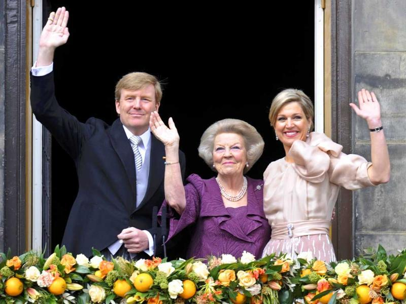 Princess Beatrix of Netherlands, her son, Dutch King Willem-Alexander and his wife Queen Maxima wave to the crowd from the balcony of the Royal Palace in Amsterdam. Netherlands is celebrating Queen's Day, which will also mark the abdication of Queen Beatrix and the investiture of her eldest son Willem-Alexander. Reuters