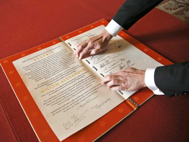 The signed act of abdication of Queen Beatrix of the Netherlands is shown after the official meeting at the Royal Palace in Amsterdam. Reuters