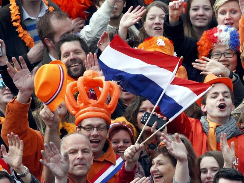 People celebrate the new Dutch King Willem-Alexander who succeeds his mother Queen Beatrix, in Amsterdam's Dam Square. Reuters