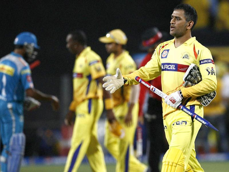 Chennai Super Kings captain MS Dhoni celebrates the victory against Pune Warriors in Pune. PTI Photo