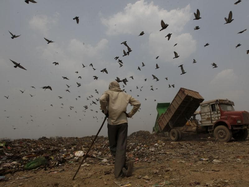 A truck unloads a fresh load of garbage at the Ghazipur Landfill site in east Delhi. Raj K Raj/HT Photos