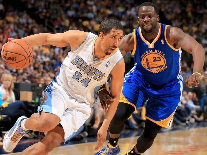 Andre Miller of the Denver Nuggets controls the ball against Draymond Green of the Golden State Warriors during Game Five of the Western Conference Quarterfinals of the 2013 NBA Playoffs at the Pepsi Center in Denver, Colorado. AFP/Getty Images