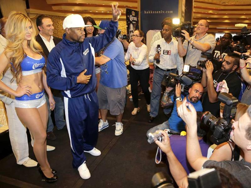 Floyd Mayweather Jr. waves to boxing fans after answering questions for the media in Las Vegas. Mayweather is scheduled to fight Robert Guerrero for the WBC welterweight championship. AP