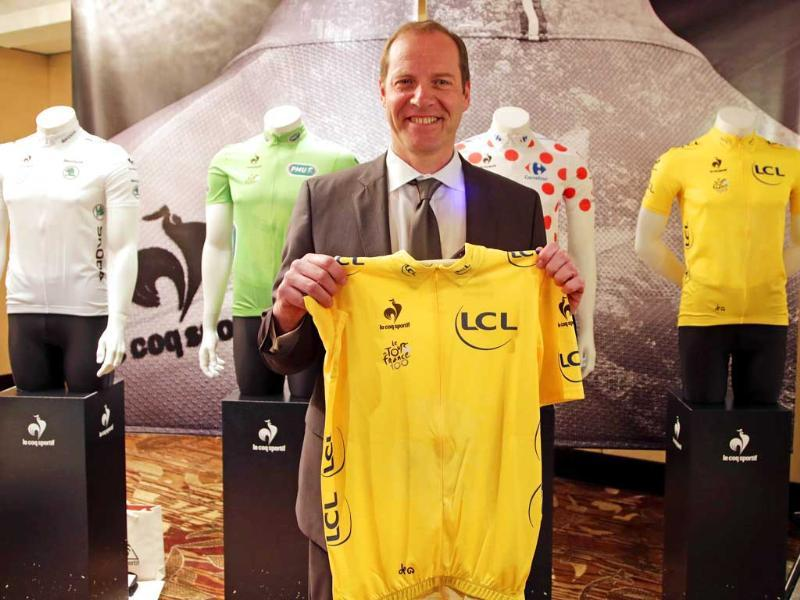 Christian Prudhomme, director of Le Tour De France, unveils the yellow jersey to be used in this year's race, in Sydney, Australia. AP
