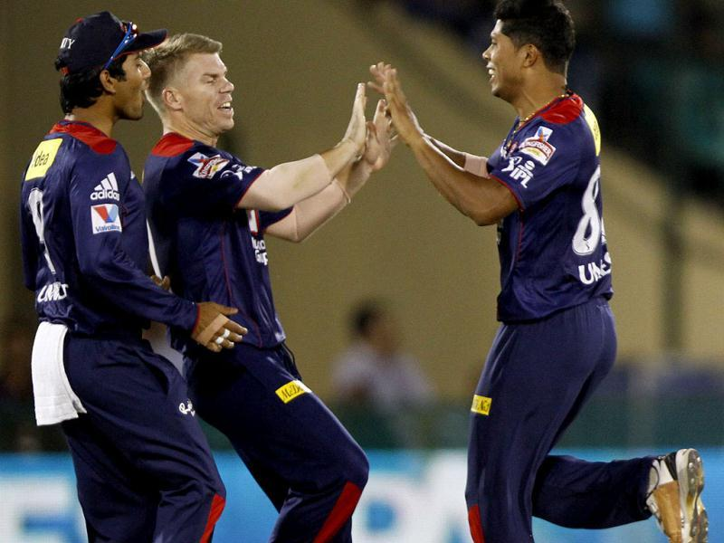 Umesh Yadav (R) of Delhi Daredevils is celebrating the wicket of M Bisla (KKR) with teammate Warner during the T20 match at International Cricket Stadium, Raipur. HT Photo/Subhendu Ghosh